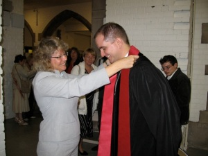 My Superintendent Yvonne fits me with my stole.