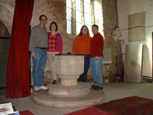 April, Jen, Mike and I gathered around the baptismal font where the Wesley children were baptised.